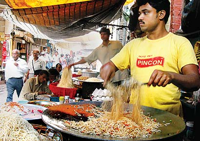 This is how Chow Mein is sold in India in streets. People love to stand and eat hot peppery & spicy chow mein.